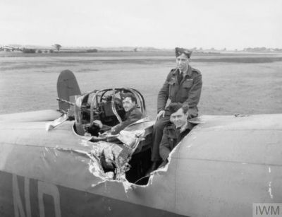 A Handley Page Halifax bomber, seen on the ground, after the bomber above it dropped bombs onto it, a terrifying and usually fatal accident. These men were very lucky. Though it looks bad, this plane was repaired, and continued to fight through the end of the war.
