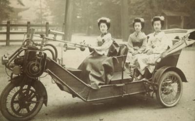 "A wild ""horseless carriage"" concept, this photo demonstrating the rather sexist marketing of the time that it was ""easy enough for a woman to drive"" which would have convinced skeptics that it was easy to use. The more carriage-like vehicles of this style would largely die out by 1900, being replaced by more ""car"" shaped automobiles to follow."