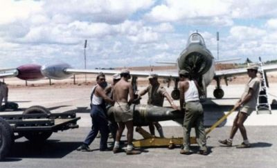 A Portuguese F-84 being loaded with bombs at Luanda Air Base, sometime in the mid 1960's.