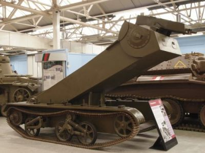 The utterly insane Praying Mantis AFV, essentially a hydraulic-powered lifting tower designed to spray machine gun fire over walls. What were the British thinking.