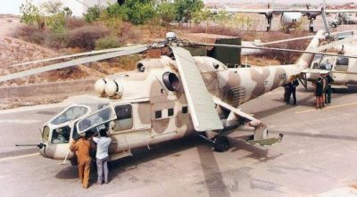 A Soviet MI-24A, the early variant which still had the forward nose gunner position.