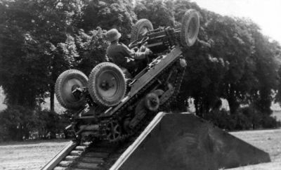 """The Mulus Tractor Crawler, 1936. Combination tracked vehicles that could adapt on road wheels to travel normally on roads (thus removing the need for overland transport) was a popular idea in the 1930's, and though Germany was forbidden from testing it for military purposes under the Treaty of Versailles, they were able to explore it's applications for farm tractors- surely it wasn't testing for the future Panzer operations... Ultimately, the Germans (along with every other country that tested the idea) found the complexity of the system and the inherent reliability issues facing a machine that had to do so many things overshadowed any benefit from it's """"convertible"""" nature."""