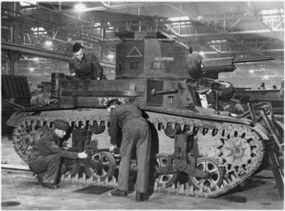 An American M2A4 light tank is assembled in the United Kingdom after it was given to the British as part of Lend Lease in 1941. After Dunkirk, the British army had lost the bulk of it's tanks- many of which hadn't been any good to begin with. The USA was quickly advancing the light tank program to the M3 Stuart, and as such was in a position to send quite a few M2 light tanks to Britain to help in their defense against a possible Nazi invasion. When the invasion did not come, the M2's saw limited service, before they were relegated to training roles.