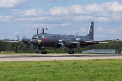 A Russian Navy Ilyushin IL-38 early warning and command aircraft with a prominent radar dome behind the nose landing gear.