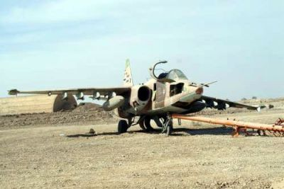 "A Soviet-built SU-25 ""Frogfoot"" ground attack jet lies abandoned by the Iraq air force following the overwhelming invasion by the United States of America in 2003."
