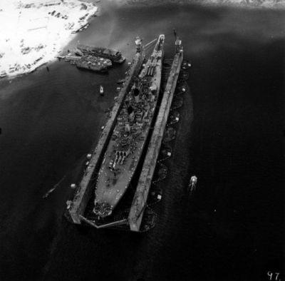 The battleship USS Wisconsin as seen in a floating repair dock near Guam Island, April, 1952.