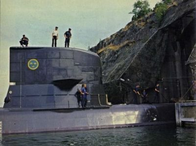 A Västergötland-class submarine heading into the Muskö underground naval facility outside Stockholm, Sweden, sometime in the 1990's.