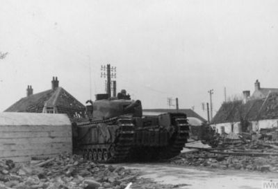 A Churchill tank returns to Dunkirk, 1944.
