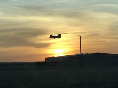 A CH-47 against a sunset.