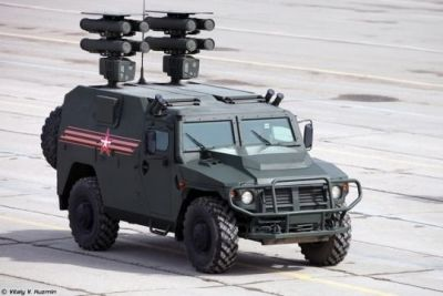 """A Russian Federation Tiger 4-wheel-drive truck, the Russian equivalent to the American """"Humvee"""" featuring the KOMET D1 rocket system, designed to destroy tanks and armored vehicles."""