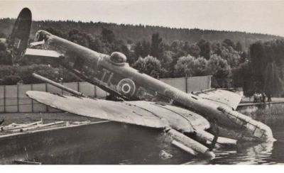 An Avro Lancaster rests partly in the water after a crash.