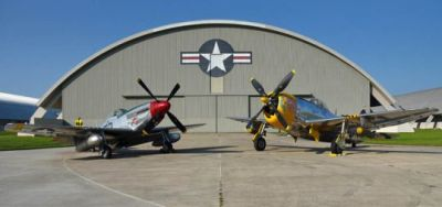 A P51 and P47 sit in the sun.