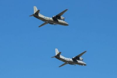 Two Antonev AN26 cargo planes fly in formation.