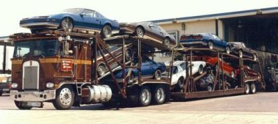 A car hauler carrying a wide array of cool things in 1984.