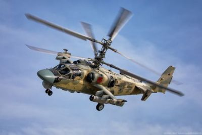 A Kamov KA-52 attack helicopter, one of the later Soviet dual-rotor designs still in service with the Russian Air Force today.