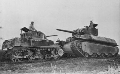 An M5 Stuart light tank goes nose-to-nose with the US M6 Heavy Tank, the army's purpose-built Tiger-killer that never saw action during the war. The photo is likely from the Aberdeen test center where the tank spent most of it's operating existence.