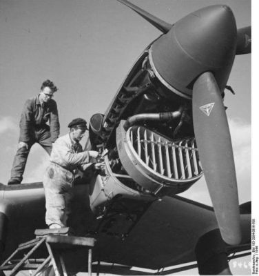 A German JU-87 Stuka Dive Bomber is serviced by a technician in 1940.