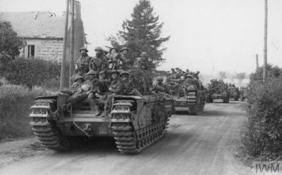 Churchill tanks roll inland at Normandy, 1944.