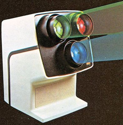 A promotional image for the 1975 VideoBeam, a tri-color video projector system based on TV technology of the time to display moving images without film. Technology like this would be used in projection setups and projection TV's until the early 2000's when LCD and then LED panels became more cost-effective for large screens, and digital projectors became more affordable- pushing the technology into obsolescence.
