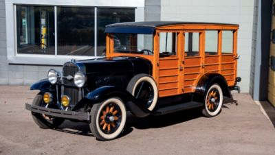 A 1929 Oldsmobile made mostly out of wood.
