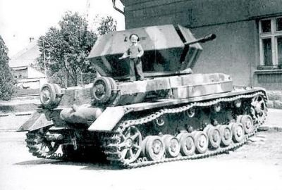A German Ostwind self-propelled anti-aircraft gun, based on the Panzer 4. Featuring little kid for some reason.