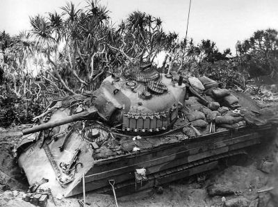 An M4 Shermanwith anti-infantry spiked armor on Iwo Jima. Tankers found that the Japanese liked to scramble all over their tanks when they could, and so protecting hatches and vision blocks with metal spikes was rather necessary for a time in some areas.