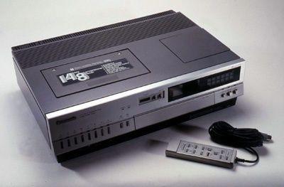 A top loading Panasonic Video Cassette Recorder (VCR).