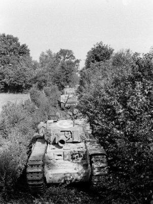 A Churchill AVRE moves through the French countryside, 1944.