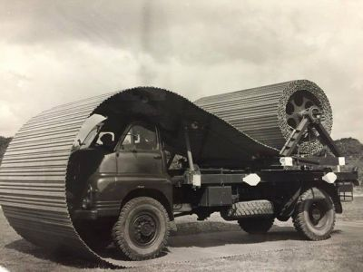 A Bedford truck outfitted to lay down sheets of roadway, which would allow heavy vehicles (like the Churchill tank) to move up and across sandy beaches much easier. The trucks were almost always used behind combat lines.