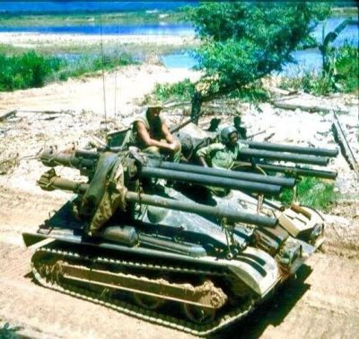 M50 Ontos assault vehicles stand ready in the mud of Vietnam.