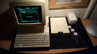 "A classic Apple IIc ""portable"" computer system set up and ready to go."