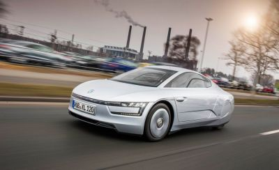 A promotional photo for the Volkswagen XL1 prototype high-mileage micro car, a very sporty look at the future that almost was.
