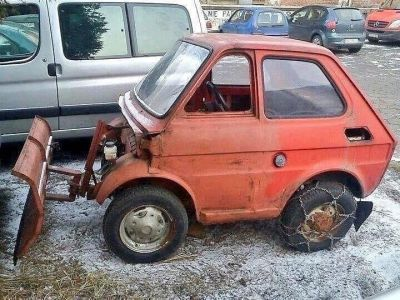 A tiny Fiat that was turned into the world's least practical snow plow.
