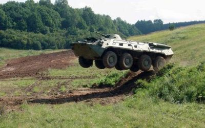 A Soviet-made BTR-70 APC leaps from the high ground, sometime in the 1980's.