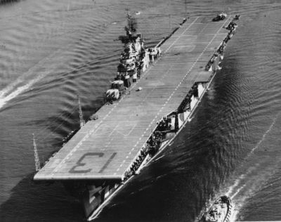 """The American aircraft carrier USS Franklin (CV-13), better known as """"Big Ben"""" at sea in 1944. The Franklin would be one of the shortest-serving Essex class carriers, fighting from January of 1944 until February of 1945 when the ship was seriously damaged by Japanese fighters, but was not sunk. Repairs were not finished until after the war, at which point the ship was essentially put into mothballs. Eventually, after slowly being re-designated to smaller and smaller potential roles in the event of a war with the USSR, the Franklin was sold for scrap in 1966."""