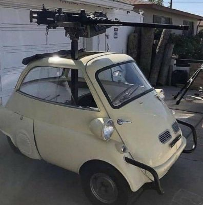 Some madlad mounted an M2 Browning onto a BMW Isetta. I do not know why.